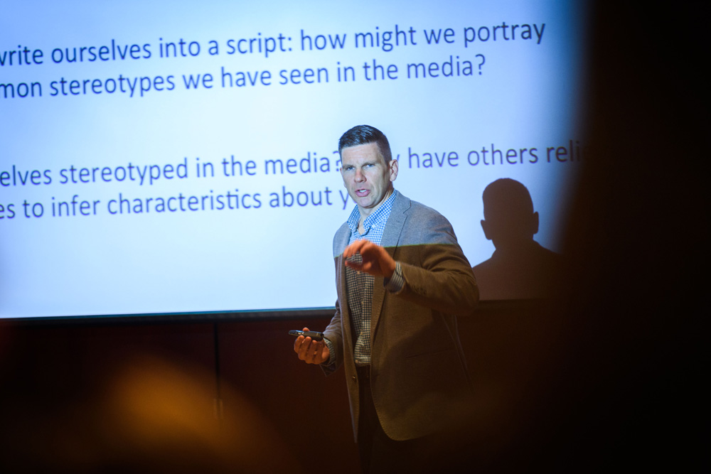 Rory McGloin, assistant professor of communication, speaks during a metanoia session on racial stereotypes in television sitcoms at Konover Auditorim