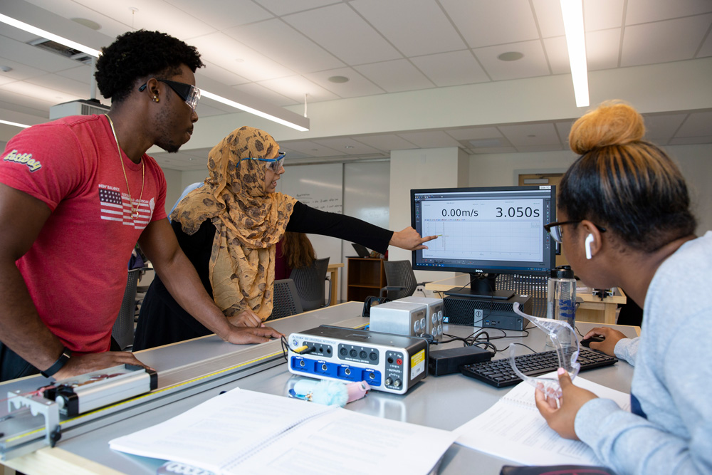 Habiba Tasnim, a Ph.D. student in the Department of Chemistry, leads a lab section of an introductory physics course in the Gant Science Complex