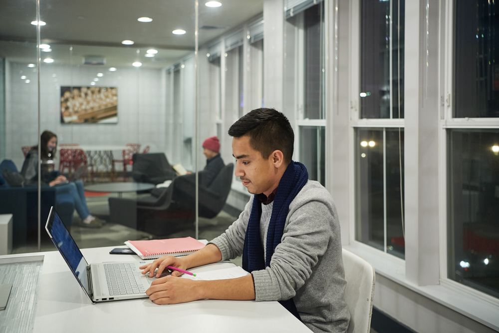 Brandon Garcia '12 (CLAS) studies in a lounge at the Stamford campus residence hall