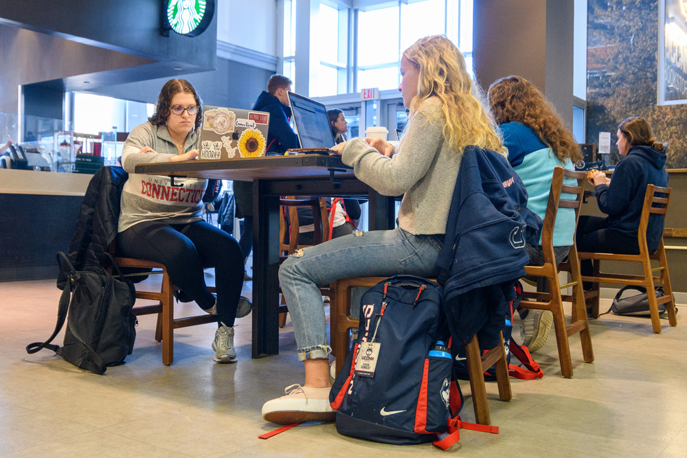 Students studying at the UConn Bookstore Cafe