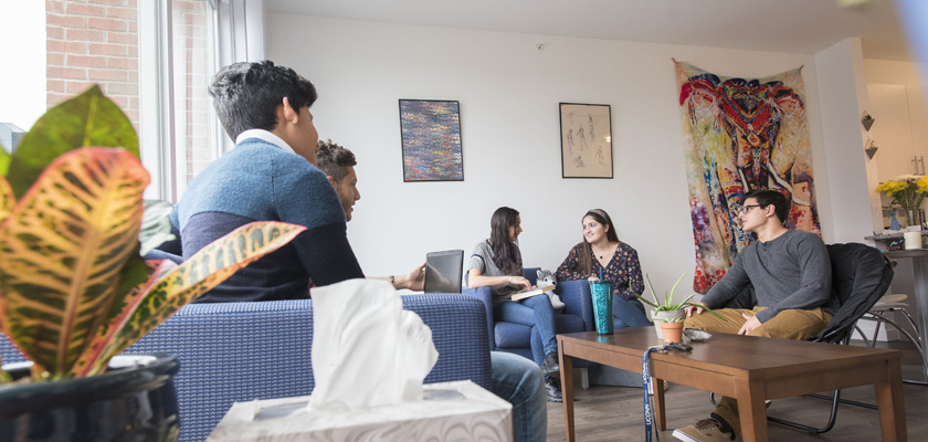 Students socializing (hanging out) in their apartment at Uconn Stamford