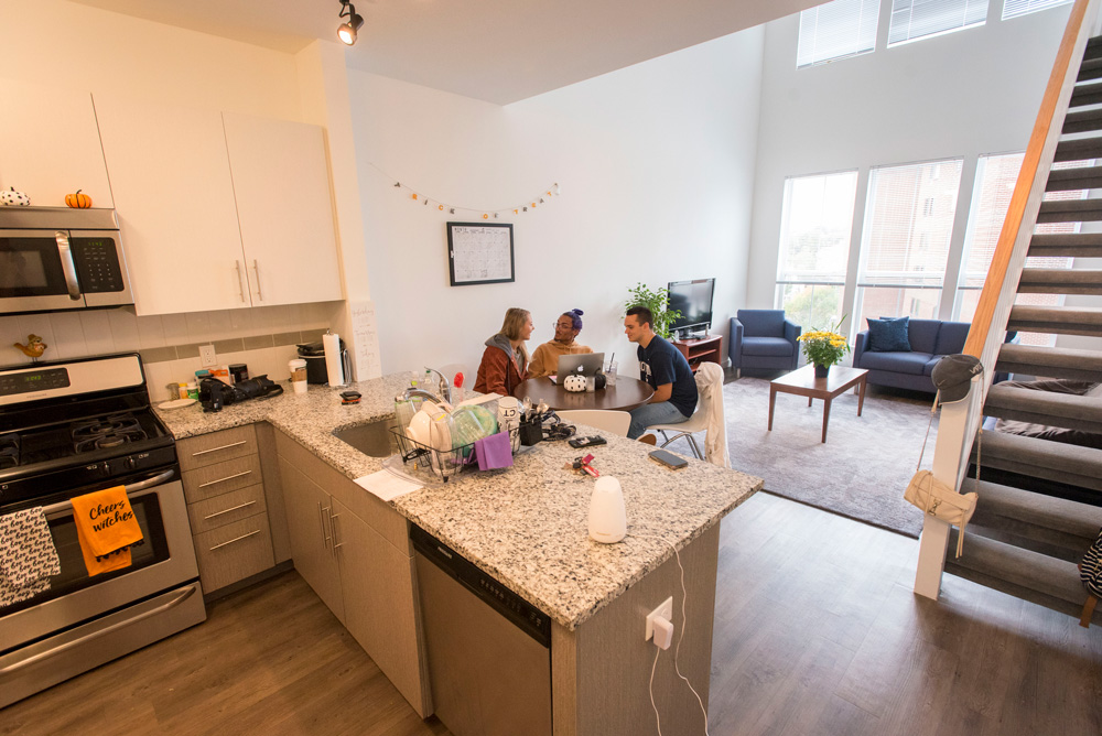 Students socializing (hanging out) and studying in their apartment at Uconn Stamford