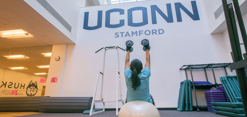 Student exercising (workout) in the gym at UConn Stamford